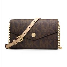 """MK CROSSBODY❤️ LIKE BRAND NEW CONDITION, The full title of this item is the """"MICHAEL Michael Kors Logo Print iPhone 5 Crossbody"""" However.. I have put my 6 in this and it fit without a case! Also you can use without putting phone in here! Has card slots also! And zip area for coins!                      ✅Bundles Trades PayPal  ✅Reasonable Offers MICHAEL Michael Kors Bags Crossbody Bags"""