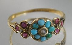 FREE POST....WORLDWIDE.....GIFT WRAPPING STUNNING LOOKING GENUINE ANTIQUE RING.....SO MUCH BETTER ON THAN IN THE PICTURES HERE WE HAVE A GENUINE EARLY ANTIQUE VICTORIAN RING FROM AROUND 1880 PERIOD.......OVER 100 YEARS OLD FABULOUS GENUINE AND NATURAL PERSIAN TURQUOISE CLUSTER RING CENTRE GEM NATURAL SEED PEARL OF THE FLOWER THE SIDE SETTING TO THE RING HAS 3 X OLD ROSE CUT BEAUTIFUL RICH NATURAL RUBY GEMSTONES AGAIN WITH A SMALL SEED PEARL IN THE CENTRES THE GOLD IS SOLID RICH 15KT GOLD…