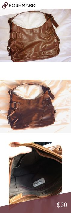 Brown faux leather purse 👛 Brown leather, gold hardware, three compartments on the inside. Has a barely visible white line/ scratch on the bottom, which can be seen in the 4th photo Bags