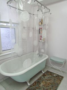Shower curtain embellished with paper doilies and Mod Podge