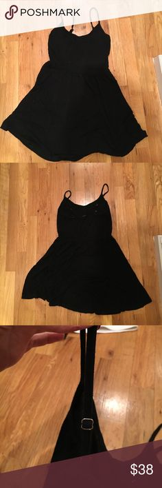 Brandy Melville black  mini dress Brandy Melville super soft and comfortable black mini dress. Straps are adjustable and there is a nice little frilly flow at the bottom Brandy Melville Dresses Mini