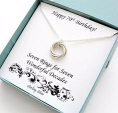 This beautiful handcrafted love knot eternity necklace features seven sterling silver rings that are intertwined and hanging from a sterling silver chain. Comes with gift box!