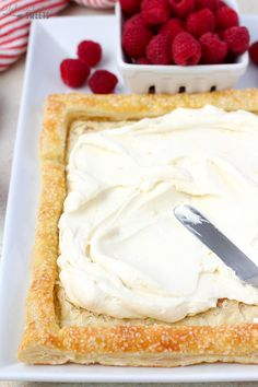 A flaky puff pastry tart filled with lemon cream and topped with fresh raspberries. An easy and elegant spring or summer dessert.