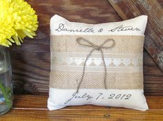If you're a bride looking for something special and unique to add to your big day then take a look at this adorable rustic chic ring bearer pillow! Customized with the bride and grooms first name and wedding date, it's the perfect sentimental addition to your special day!    ***Already filled wit...