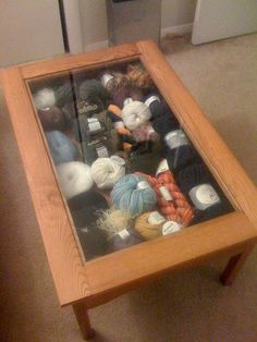 Now, this is a small-space craft storage idea I can use. Cleverly stash yarn inside a glass-topped coffee table. It looks beautiful and decorative, and you could fire up your needles or hook at a moment& notice. Knitting Room, Knitting Yarn, Yarn Storage, Craft Storage, Creative Storage, Storage Ideas, Yarn Crafts, Diy Crafts, Wooly Bully