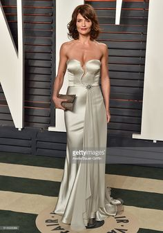 Model Helena Christensen arrives at the 2016 Vanity Fair Oscar Party Hosted By Graydon Carter at Wallis Annenberg Center for the Performing Arts on February 28, 2016 in Beverly Hills, California.