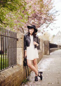 leather jacket + white dress + black hat + black heels