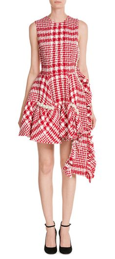 In red and white printed bouclé, this Simone Rocha dress is a new statement spin on ladylike polish. The heritage fabric is detailed with a trim of faux pearls, but offset with a voluminous ruffle at the front #Stylebop