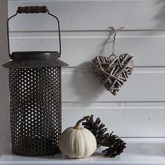 Fall mantel decoration in brown lantern pinecones wicker heart via songbirdblog
