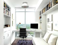 all white home office with moroccan rug and built in desk near window