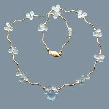 Aquamarine Throat Candy  Excellent quality Aquamarine briolettes and 14k gold-filled beads and squiggle tubes with a 14k clasp.