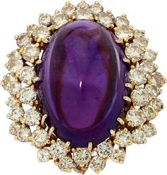 Amethyst, Diamond, Gold Ring. ...The ring features an oval-shaped amethyst cabochon measuring 27.00 x 18.15 x 14.00 mm and weighing approximately 49.05 carats, enhanced by full-cut diamonds weighing a total of approximately 5.45 carats, set in 18k gold. Gross weight 23.40 grams. Size: 7-1/4 (not easily sized) Estimate: $3,000 - $5,000.