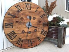 Urban Patina: Upcycled electrical wire spool into large focal point wall clock