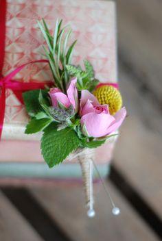 Buttonhole - spray rose, flowering mint, craspedia and rosemary.