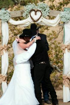 First kiss as married couple...A♡K #stefanieelizabethphotography #countrywedding #rustic #ranch #countrylife #boots #cowboyhats #californiaweddings #shabbychicwedding #ranchwedding #cowboyboots #country