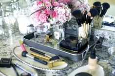 Pink Peonies i love the makeup grouped and in trays with flowers