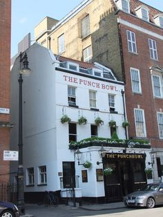 The Punch Bowl Public House, Farm Street, Mayfair. The Punch Bowl is a London public house, dating from 1750, the second oldest in Mayfair. It is a Georgian building, and although altered over the years, it retains many periodic features including a dog-leg staircase, internal cornicing and dado panelling. Photo by Paul Farmer