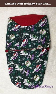 LImited Run Holiday Star Wars Swaddler with Velcro. Perfect gift for a baby shower, these swaddlers are ready to ship today. Each snuggles the new baby in the comfort of flannel and fandom. The velcro closures make these perfect for sleep deprived parents (we are all sleep deprived) and the swaddling makes the baby feel safe. Also, machine washable! This one has an soft red flannel lining and the outside is festives ships including: Slave I, Death Star, X-wing, Millennium Falcon and Tie...