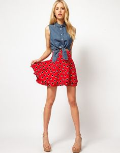 ASOS Skater Skirt in Large Spot    Flippy skirt by ASOS Collection. Crafted in a lightweight fabric. Featuring an all large spot print, high waistline, gantly gathered skirt and a tiered hem. Designed with a full mini cut