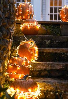 Brighten your traditional outdoor decor with a much needed update by simply wrapping pumpkins in string lights.
