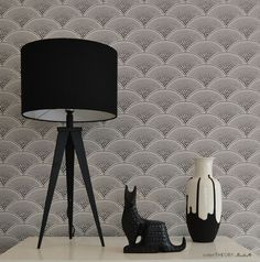 All black and white styling in this vignette with such gorgeous fan-pattern black wallpaper.