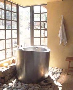 Japanese Soaking Bath.  I've always wanted one of these.  Not sure what material to make it out of yet.  I've seen tile, wood, copper and stainless.  What would be the easiest to take care of?  Hmmm...