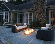I just like the built in fireplace...now THATS cool.  Maybe get some wicker furniture instead of the leather?