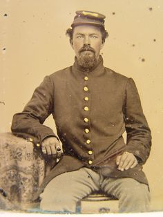 Unidentified soldier in Union uniform. From: Soldiers of the Civil War.