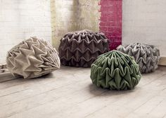 Pine cone-shaped seats created by steam-folding wool felt.