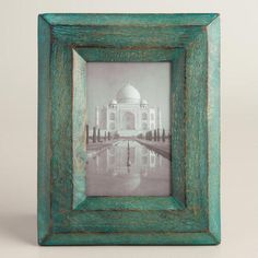 Hand painted in a muted shade of green, our wooden frame lends color and depth to a photo with a raised profile and distressed embellishment.