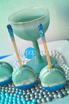 """""""Champs & Macs"""" the perfect dessert for 2013, micro vanilla bean macarons with Champagne and SweetWorks  sugar pearls; original design by Le Pop Shop, follow us on Facebook"""