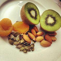 Paleo snack..kiwi, almonds, apricots,and pumpkin seeds