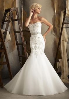 Stunning strapless wedding gown with fishtail bottom and jewel detail throughout dress...available now in store!