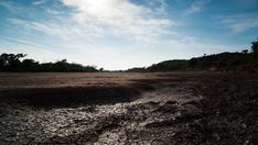 A linear daytime timelapse showing a dry riverbed with mud cracks drying up as the heat of the day increases with cumulous clouds moving across. Hd Video, Stock Footage, Mud, Country Roads, African, Clouds, Landscape, Beach, Water
