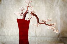 This listing is for a handcrafted beautiful bonsai tree branch arrangement made of white & red beads for leaves and copper wire for branches. It…