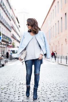 Winter outfit: light blue biker jacket, cream sweater, beige bag, distressed skinny jeans, blue booties