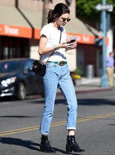 On Kendall Jenner: Ray-Ban 50mm Rounded Sunglasses ($150); Re/Done | Hanes The 1950s Boxy Tee ($78); Gucci GG Marmont 2.0 Bag ($1890) and belt; Louis Vuitton boots.