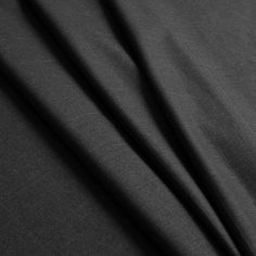 """Here we have an extremely soft 'Super 150' dark shadow gray pure wool and cashmere suiting with a windowpane check pattern. Super 150 is the thread count which gives the wool a very light-weight and soft hand. Most tailors would prefer this suiting for a special occasion apparel rather than everyday use. Laying at 62"""" in width, this fabric is soft and flexible, so it will drape extraordinarily well. Perfect for suit jackets or those perfect pair of suit pants."""