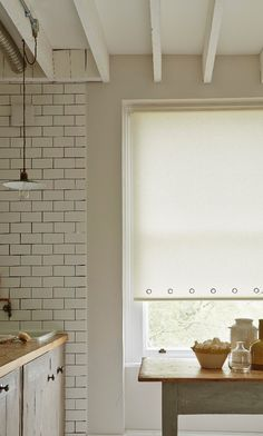 Use textures in the same colour to create impact within a room. Add accessories in dark colours and wood to complete the look, made to measure cream Roller blinds with eyelets create an interesting look.