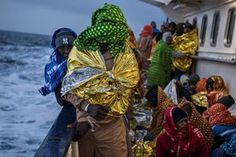 Refugees and migrants are photographed on the deck of the rescue vessel Golfo Azzurro  as it sails towards the Italian port of Pozzallo after they were rescued off the Libyan coast north of Sabratha.