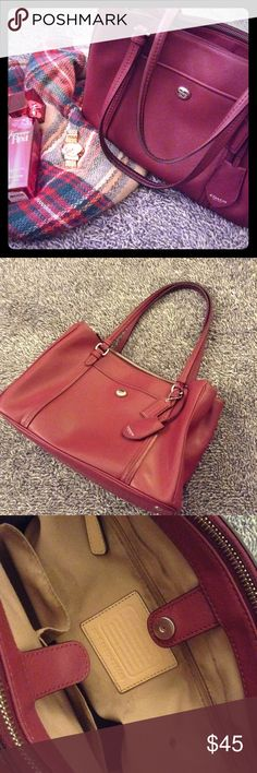 Maroon/berry colored Coach bag. Perfect for fall🍂 Pre-loved Coach handbag. Nice maroon color with lots of pockets and storage. 3 interior compartments. 2 large zippered sections. 2 exterior pockets. Large inside section shows normal signs or use-minor pen marks, a few spots, etc. Silver hard wear. Smoke free. Handles are dark where they have been used. Not noticeable when holding or when positioned on shoulder. Need a name brand bag that won't break the bank for this fall? Well you found…
