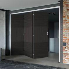 An absolutely on trend folding doors perfect for a modern urban style interior design. Indoor Plant Lights, Internal Folding Doors, Primed Doors, Garage Door Design, Industrial Windows, Contemporary Doors, Architrave, Door Sets, Oak Doors