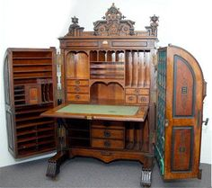 EXTRA GRADE CABINET SECRETARY DESK. Sold for $32,000 in 2006. Walnut and burled walnut panels