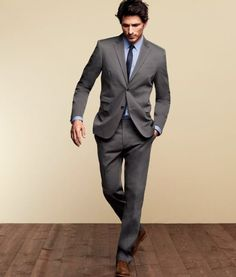 Gray suit, powder blue shirt, navy tie. Finished off with brown shoes.
