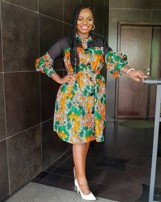 Check out latest orange ankara gown styles