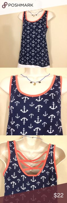Simply Irresistible Navy Tank with Lace Up Back Simply Irresistible navy blue tank top with an anchors design and a lace up back. Trimmed in a beautiful coral color. The size extra small measures 14.5 inches across the bust unstretched 25 inches down the front and 27 inches down the back. The small measures 15 inches across the bust 25 inches down the front 27 inches down the back. The medium measures 15.5 inches across the bust 25 inches down the front and 27 inches down the back. Simply…