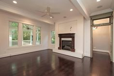 Love the floor, fireplace and passageway with transom window  ||  Frank Batson Homes - Nashville, Tennessee