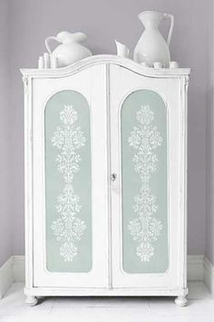 Love this look! Stenciling on the front doors of an armoire with a romantic floral design.