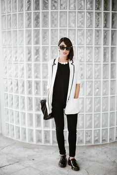 Shop this look on Lookastic:  http://lookastic.com/women/looks/pearl-necklace-and-blazer-and-crew-neck-t-shirt-and-skinny-pants-and-derby-shoes-and-crossbody-bag/3749  — White Pearl Necklace  — White and Black Blazer  — Black Crew-neck T-shirt  — Black Skinny Pants  — Black Leather Derby Shoes  — Black Leather Crossbody Bag