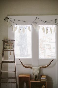 DIY Printed Paper Feather Garland via Sincerely, Kinsey